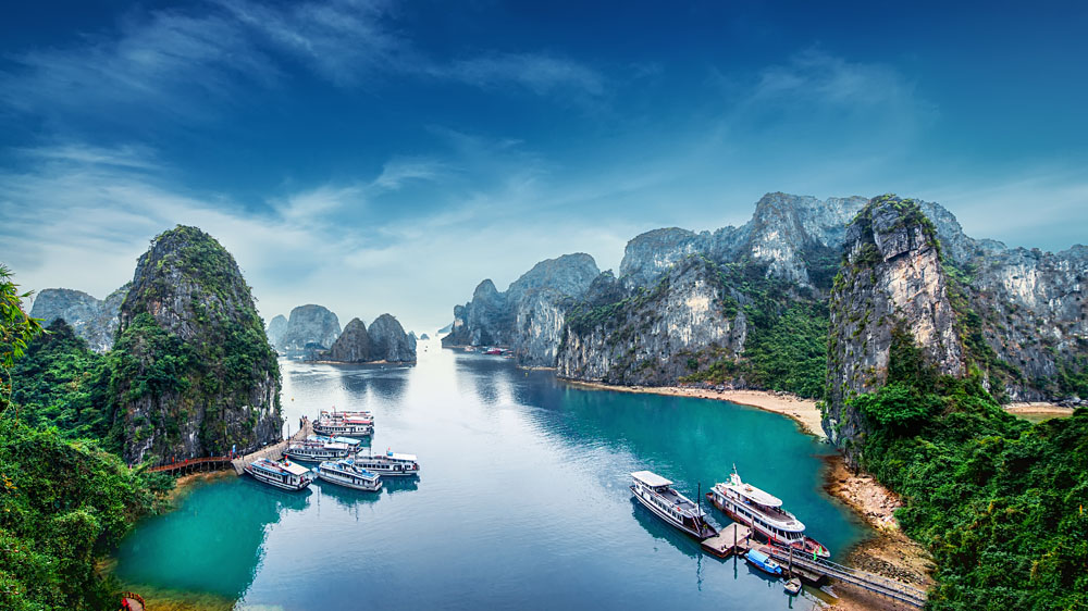 Tourist Junks Floating Among Limestone Rocks at Halong Bay, Vietnam