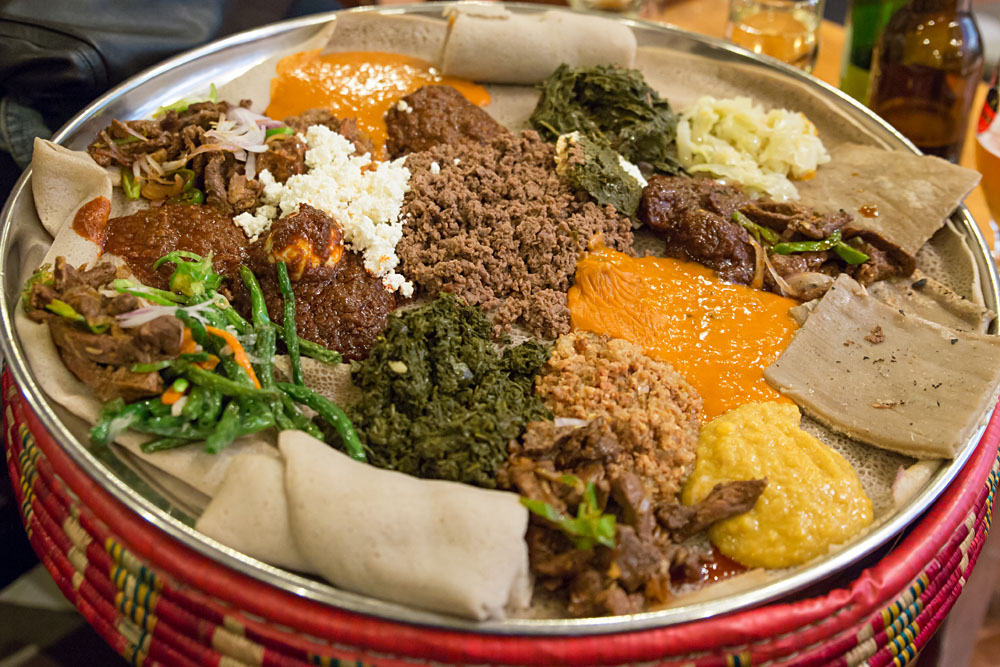 Traditional Ethiopian Food with Stews and Meats Served on Injera, Ethiopia