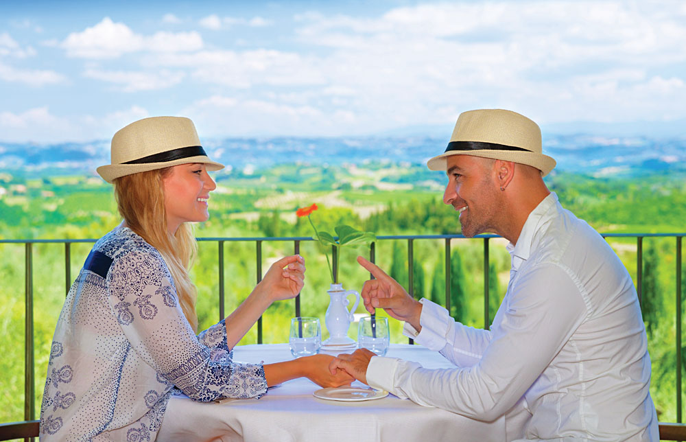 Young Couple Having Breakfast on the Terrace in Tuscany, Italy