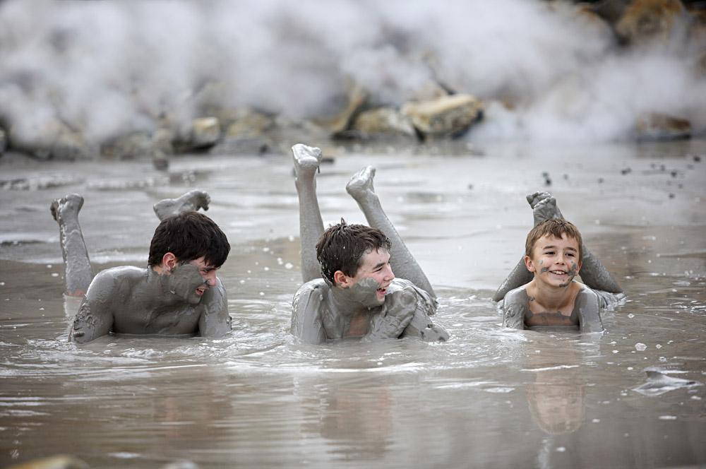 Mud bathing at Hellsgate Geothermal Park in Rotorua, New Zealand