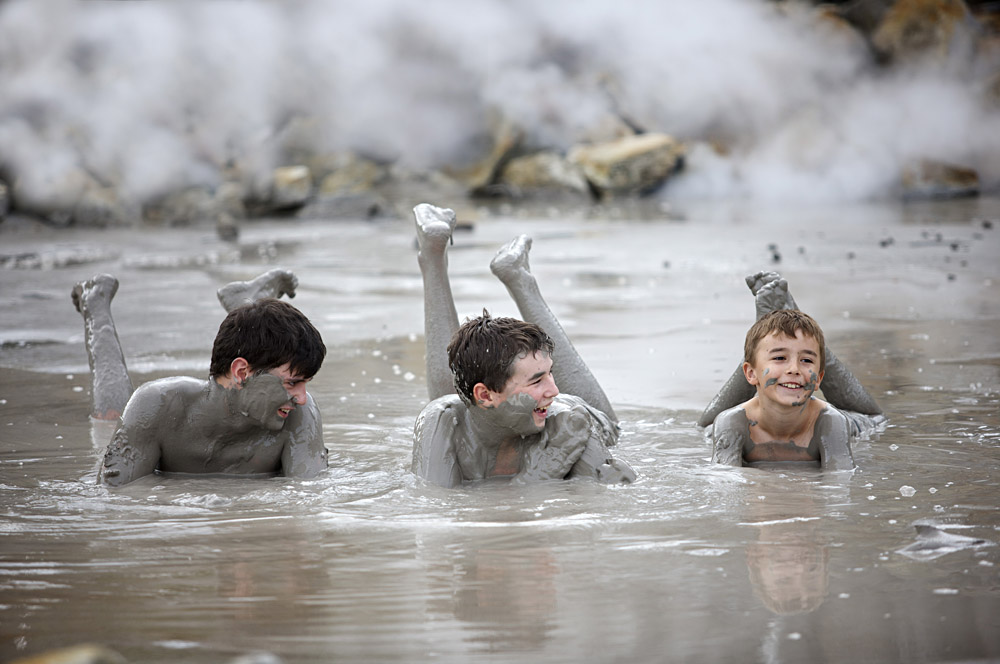 Mud bathing at Hellsgate Geothermal Park in Rotorua, New Zealand