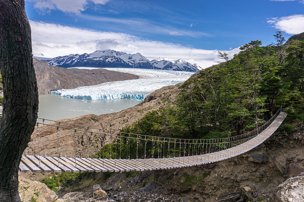 Suspension Bridge over Lago Grey with Glacier Grey in Background, Southern Patagonia, Chile