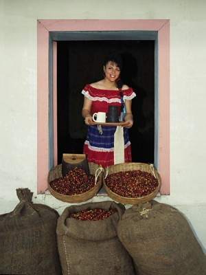 Woman in Traditional Central American Dress Serving Coffee from Window, El Salvador