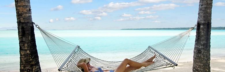 Young Woman Relaxing in Hammock in Aitutaki, Cook Islands