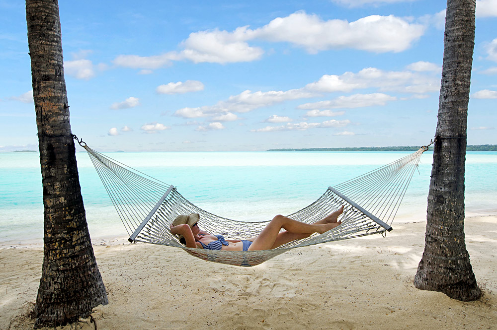 Young Woman Relaxing in Hammock in Aitutaki, Cook Islands