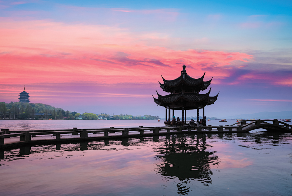 Ancient Pavilion Silhouette at Sunset on the West Lake in Hangzhou, China