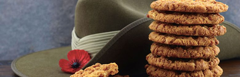 Anzac Biscuits with Soldier Slouch Hat and Poppy on Dark Vintage Background