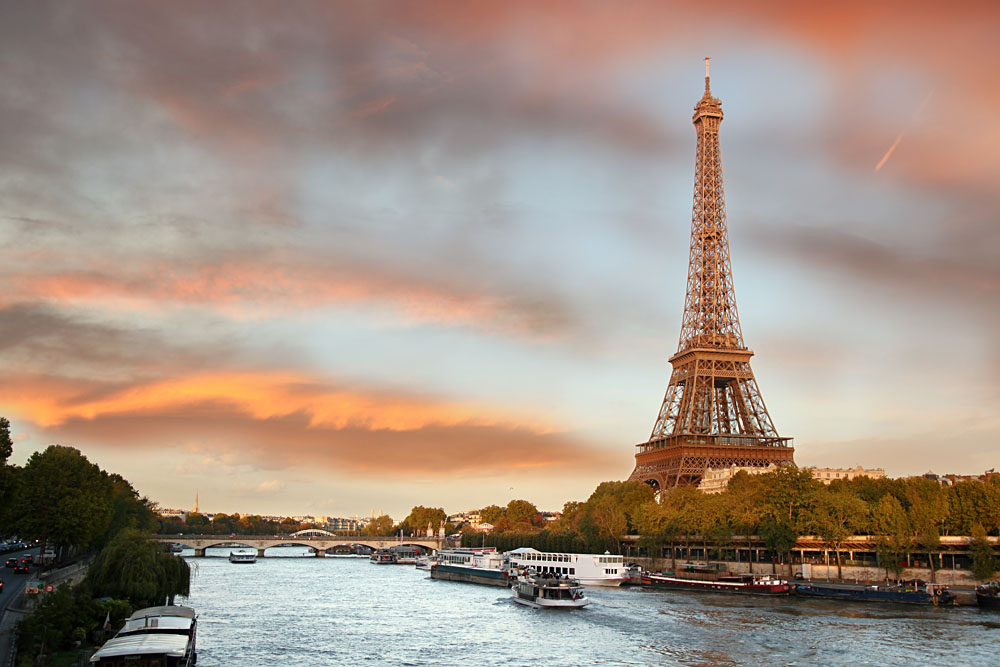Eiffel Tower with Boats on the River Seine in Evening Paris, France