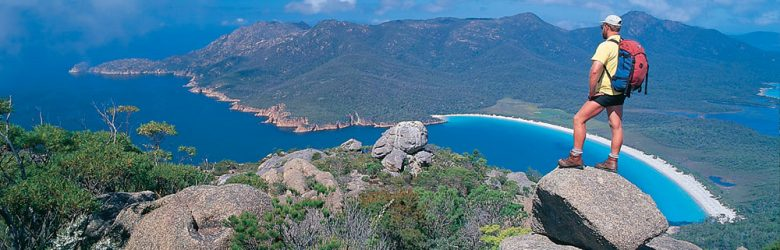 Hiker Overlooking Freycinet National Park, Tasmania, Australia