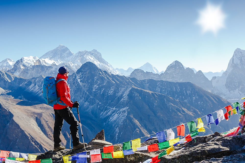 Hiker with Backpack Standing on Top of a Mountain in Himalayas, Nepal