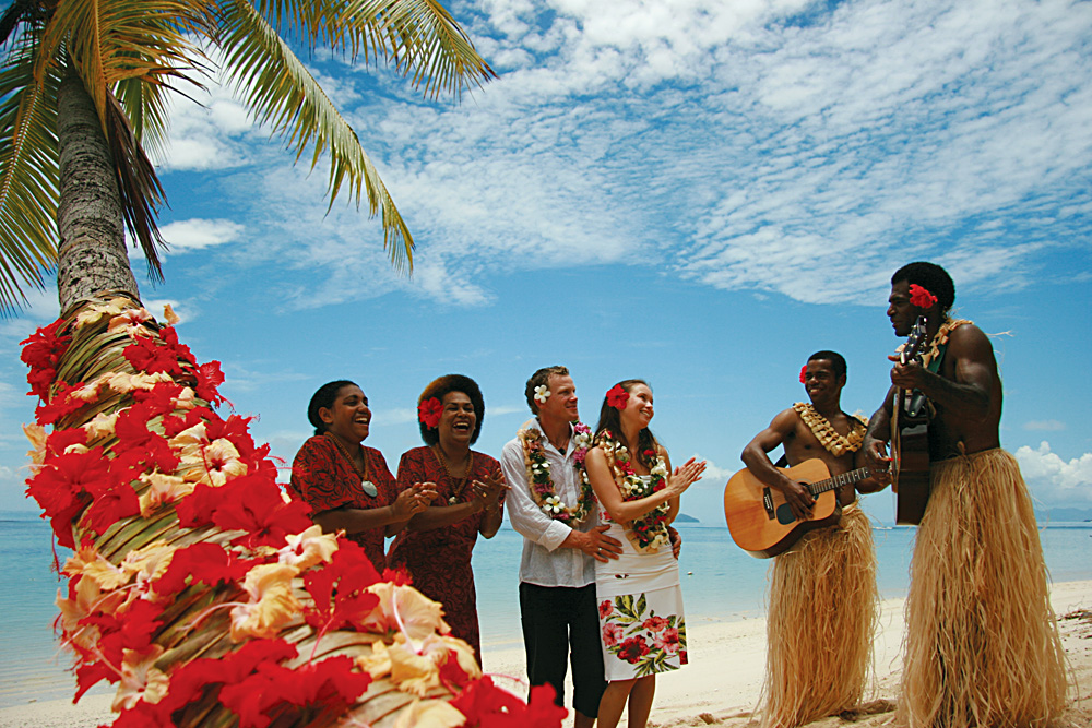 Couple on Beach with Musicians, Fiji