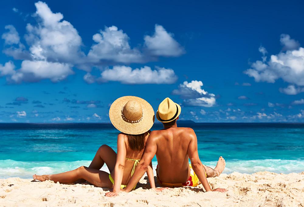 Couple on a Tropical Beach at Seychelles