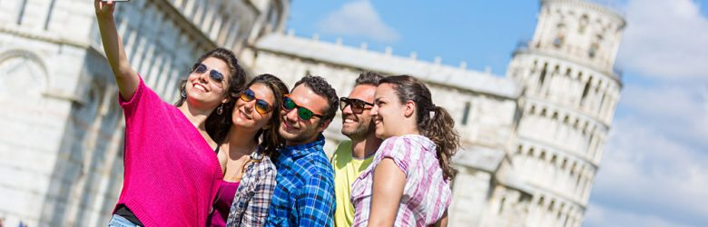 Group of Tourists Taking a Selfie in Pisa, Italy