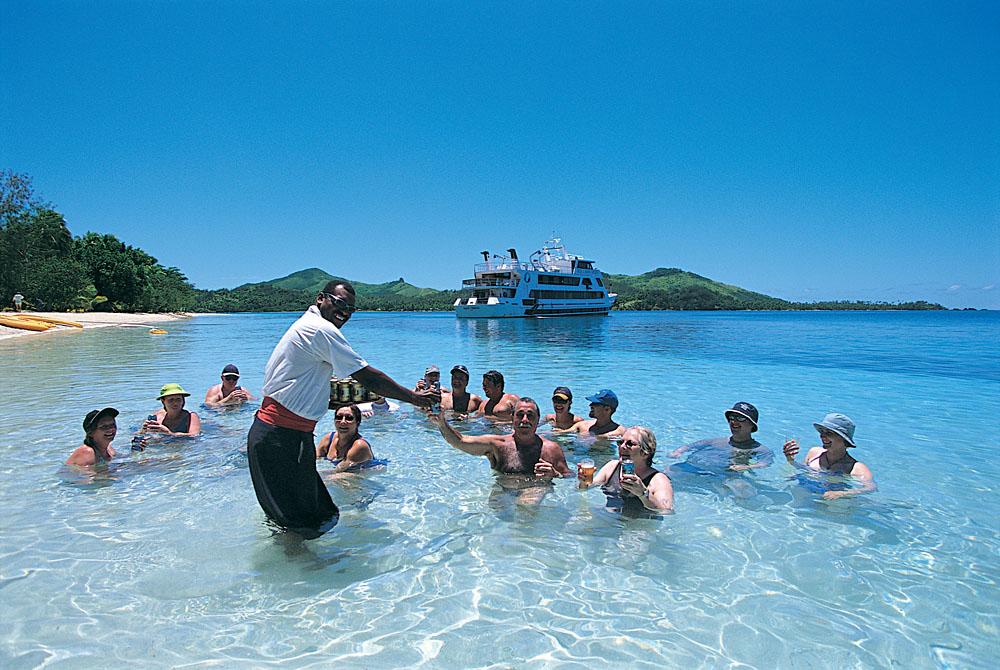 Enjoy drinks on the beach with Blue Lagoon Cruises, Fiji