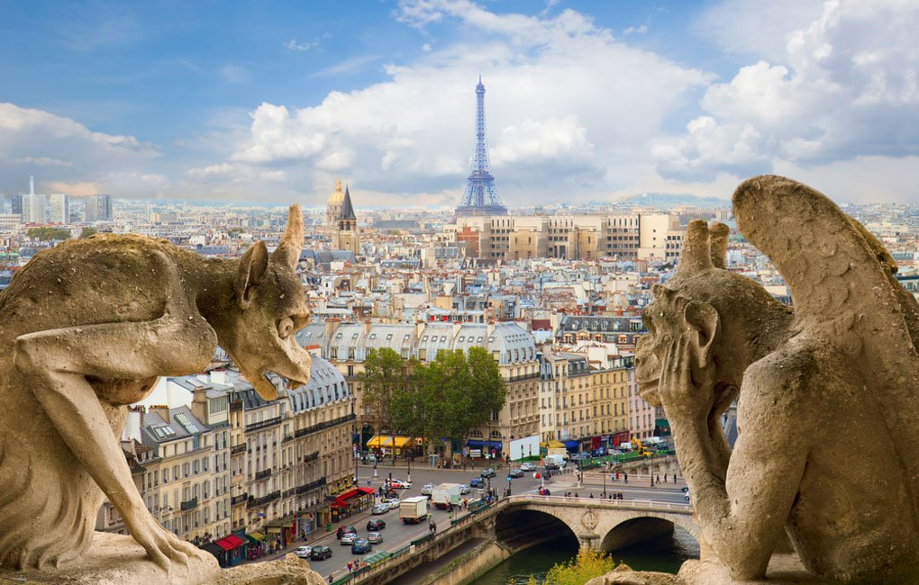 Gargoyle on Notre Dame Cathedral and city of Paris France