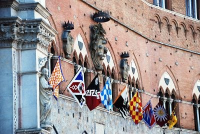 Banners of the Contrades at Piazza del Campo in Siena, Italy