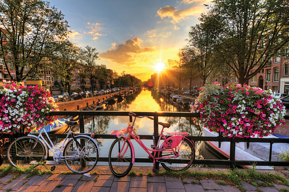 Beautiful Sunrise, Bicycles, and Bridge Over Amsterdam, The Netherlands