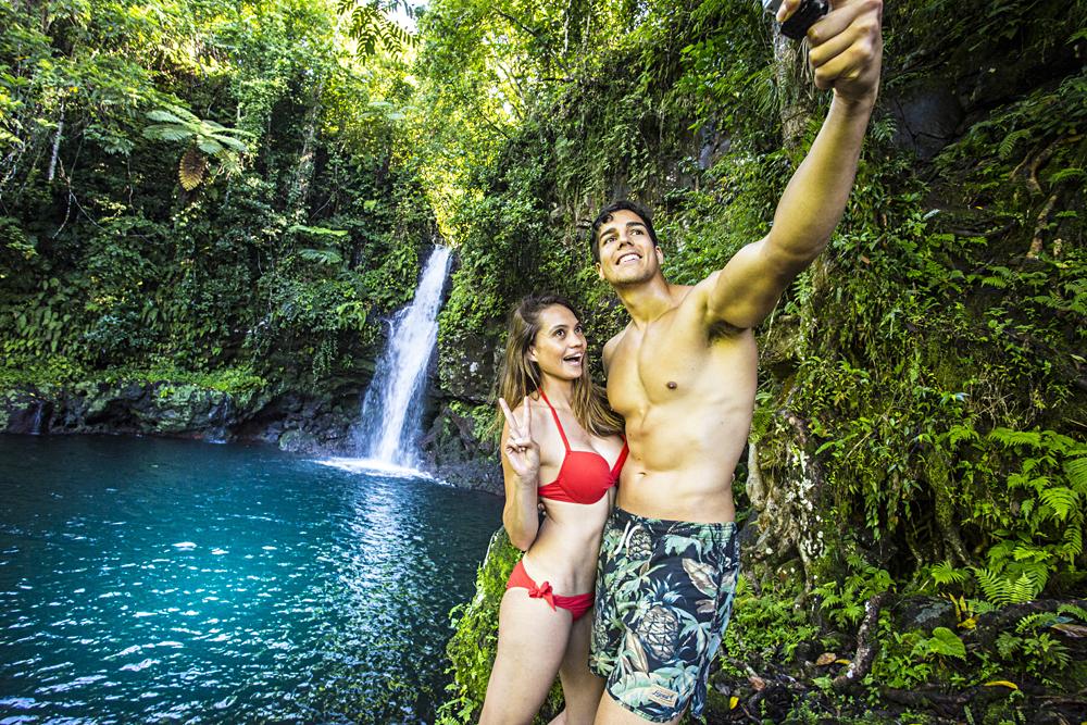 Couple Taking Selfies at Afu Aau Waterfall, Savaii, Samoa