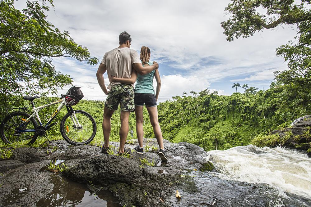 Couple at Fuipisia Waterfall, Upolu, Samoa
