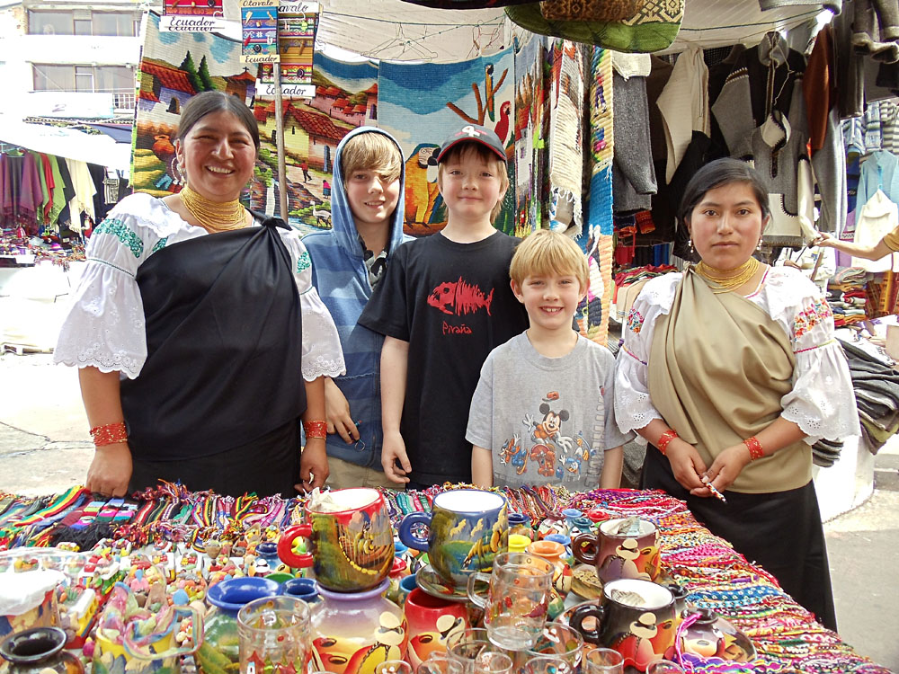 Don Forster - Boys with Market Stall Keepers in Otavalo Market, Ecuador