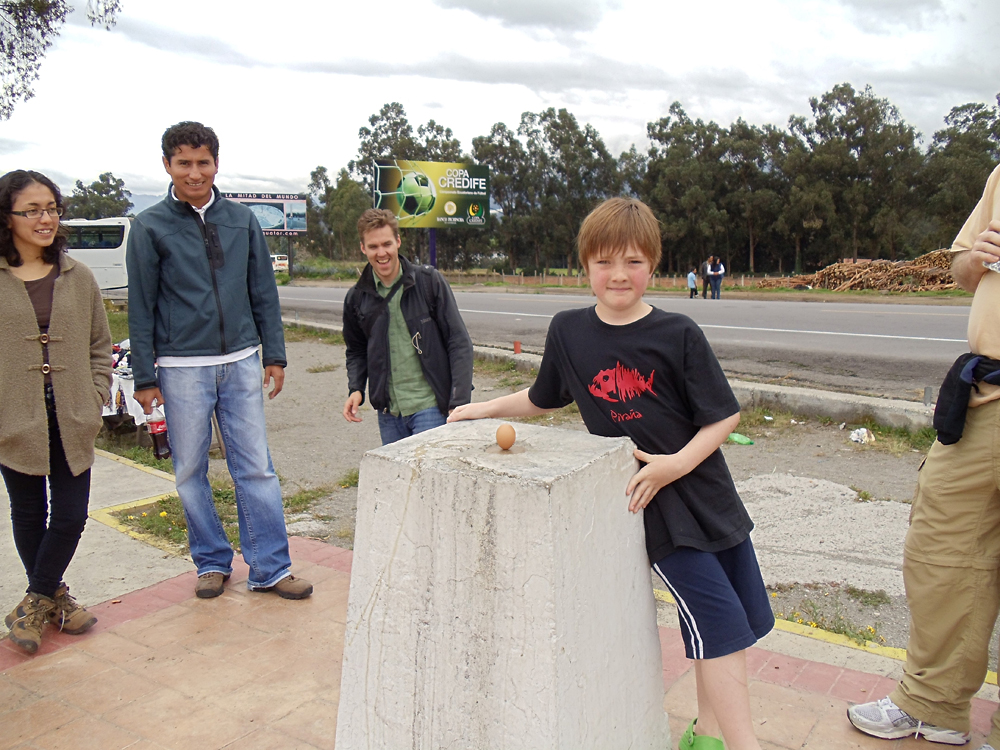 Don Forster - Ethan Balancing an Egg at the Equator - Mitad del Mundo Near Quito, Ecuador