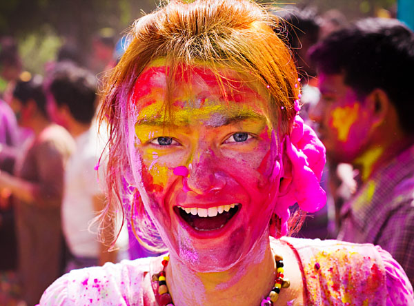 Female Tourist with Students Celebrating Holi, India