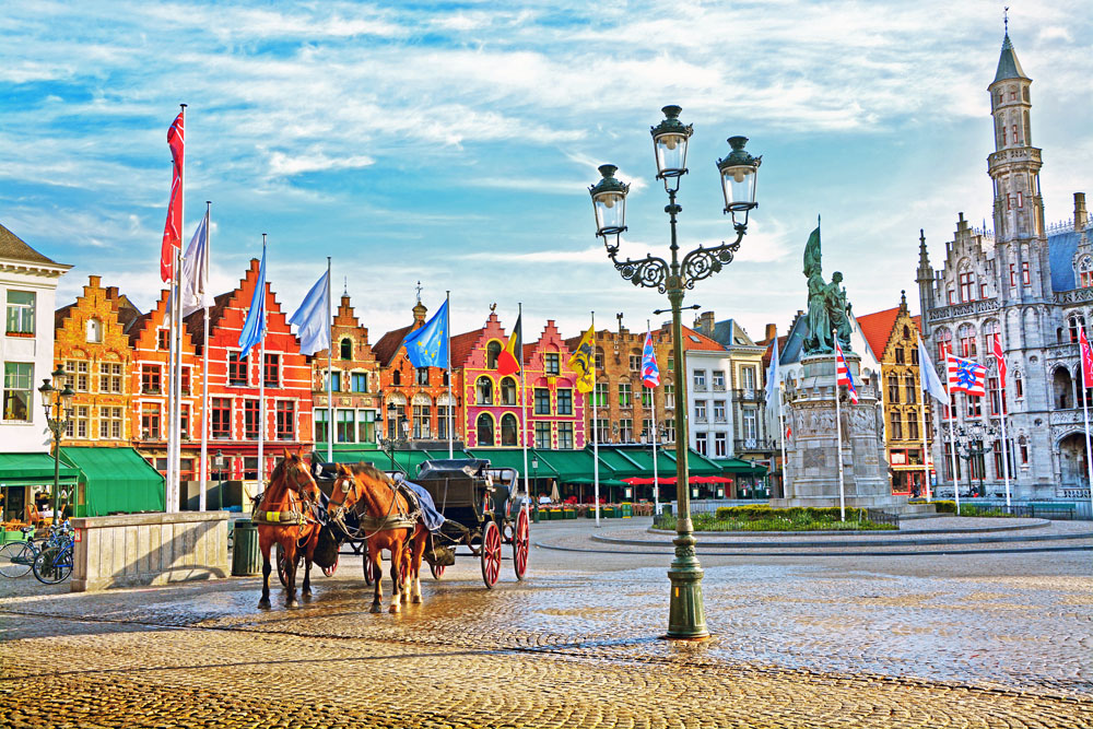Horse Carriages in Grote Markt Square in Bruges, Belgium