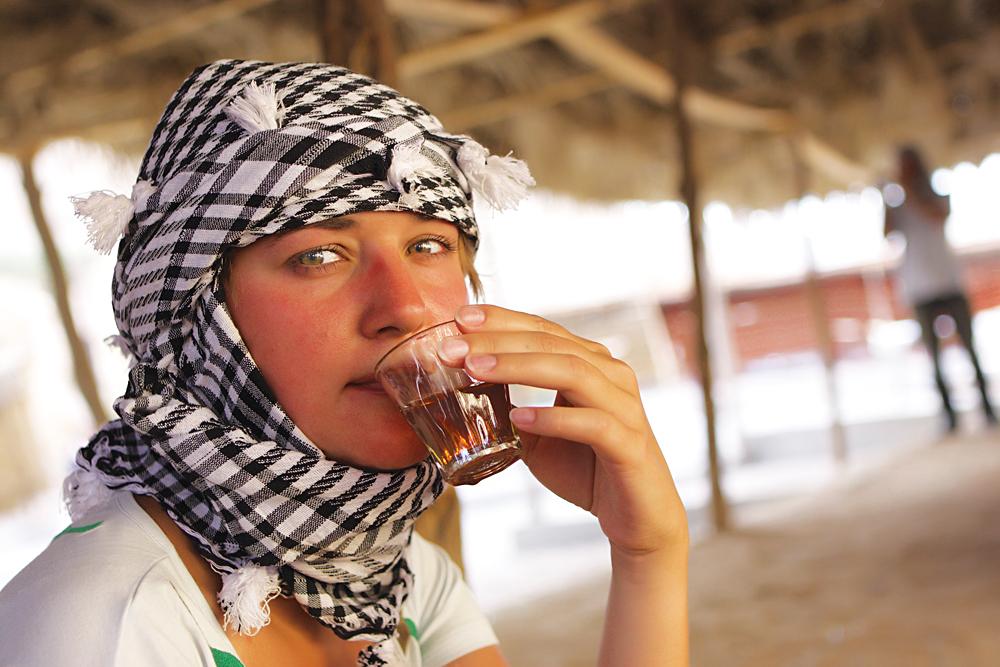 Tourist Drinks Bedouin Tea in Bedouin Tent