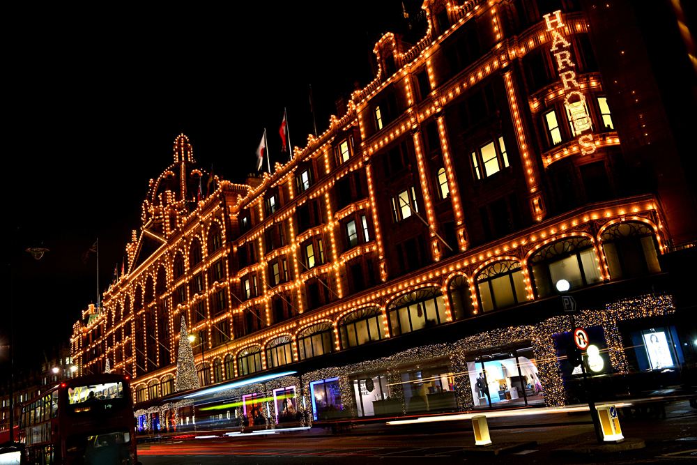 Harrods lit up at night, Knightsbridge, London, England, UK