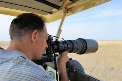 A professional photographer on an African safari in Kenya