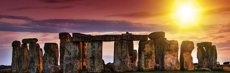 Sunset at Stonehenge with Dramatic Sky and Sun Rays, England, UK
