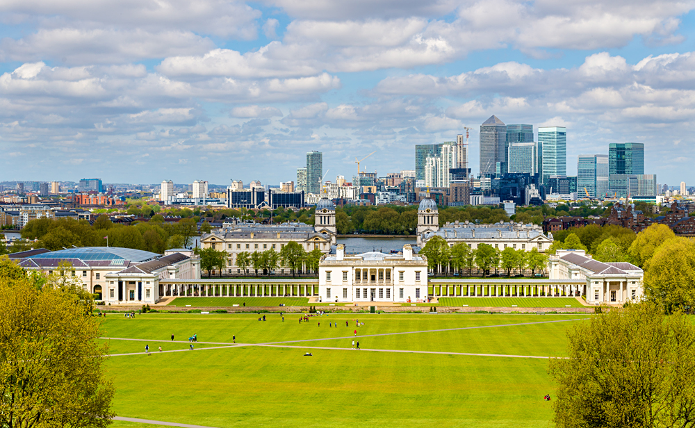 View of the National Maritime Museum in Greenwich and Canary Wharf in Background, London, England, UK