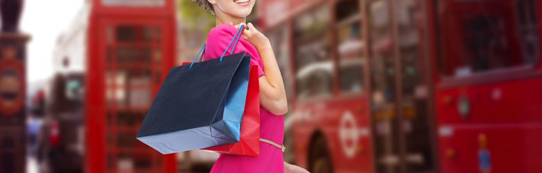 Young Happy Woman with Shopping Bags on London Street, England, UK