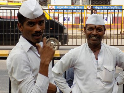 Friendly Dabbawalas in Mumbai, who collectively deliver more than 200,000 lunches per day, Mumbai, India
