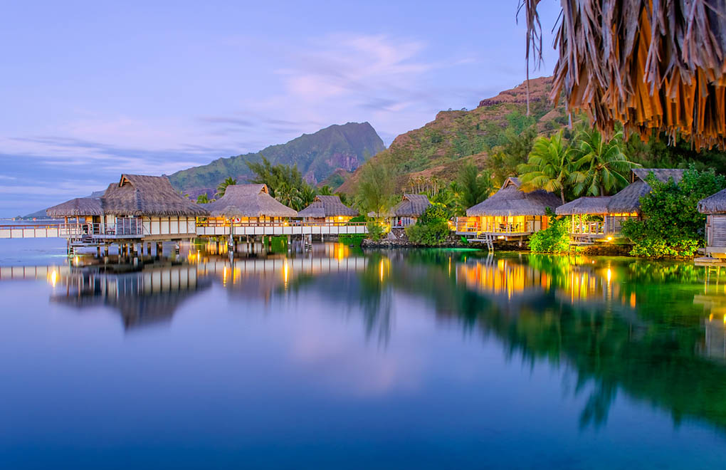 Overwater bungalows at dusk