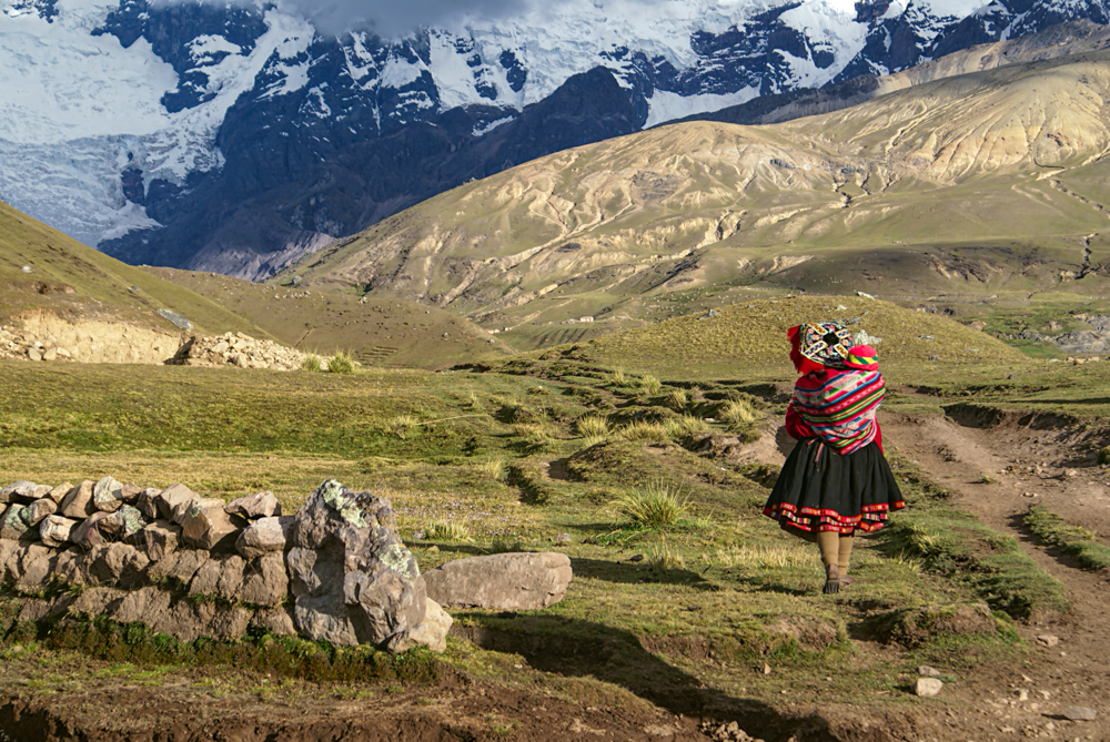 Peruvian Woman Walking with Child in Andes, South America