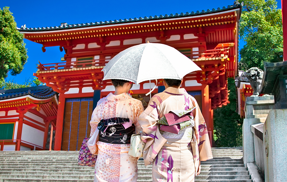 Japanese Girls in Traditional Clothing Walking in the Yasaka-Jinja Shrine in Kyoto, Japan