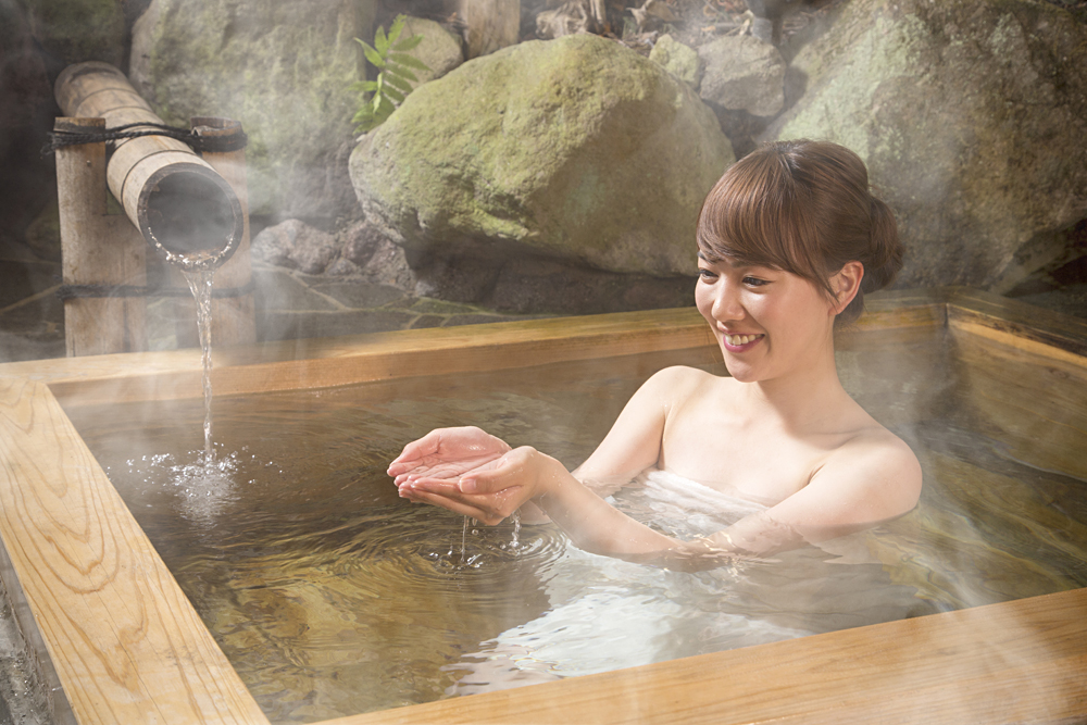 Japanese Woman Relaxing in the Hot Springs Bath, Japan