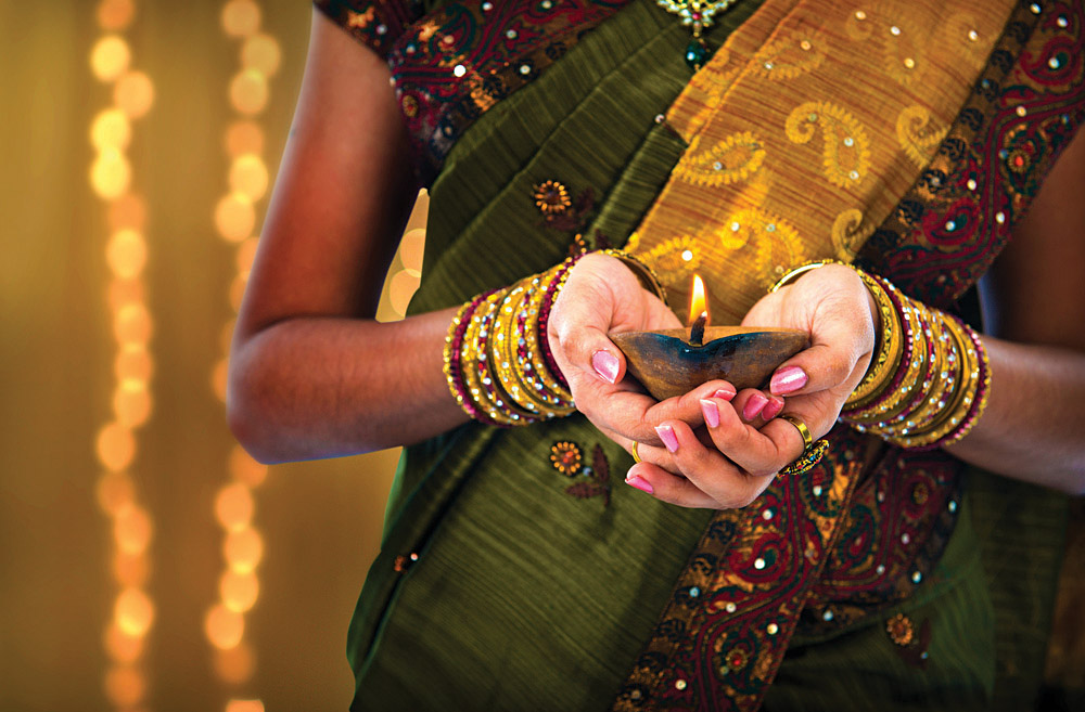 Woman Holding Diya at Diwali, India