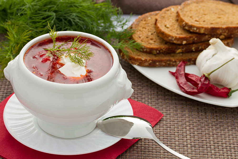 Russian Borscht in White Bowl with Dill and Bread Slices