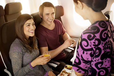 Air New Zealand - Couple Dining in Economy on Boeing 7879_0156509_1