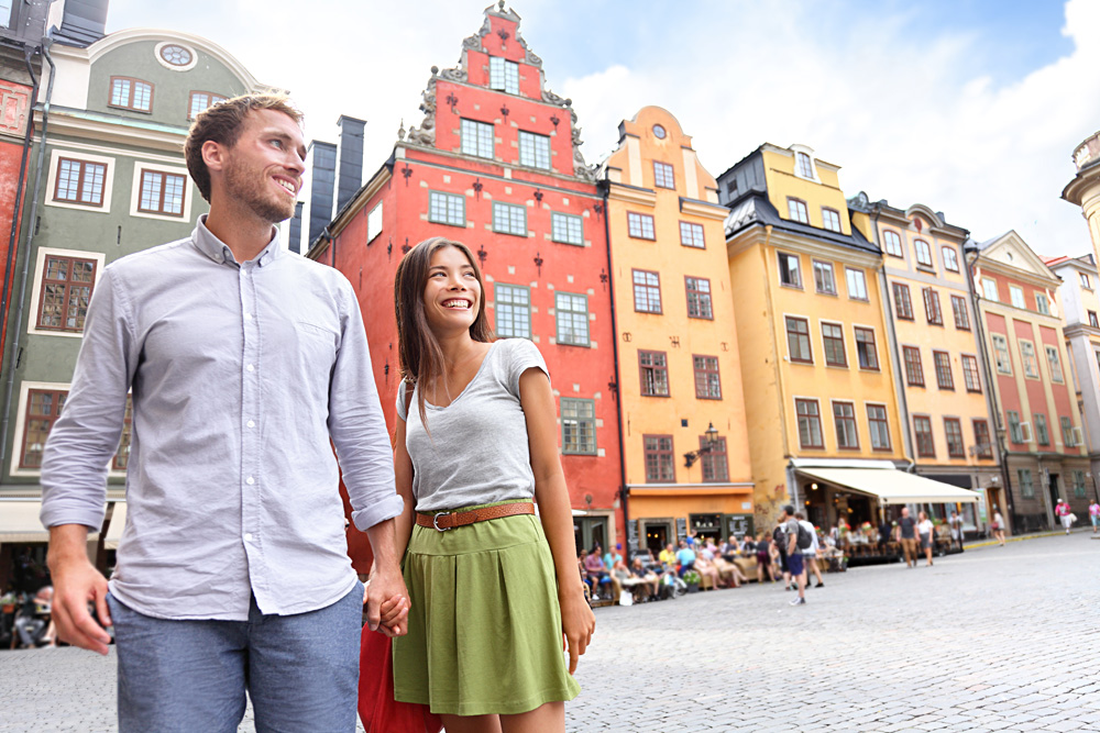 Couple in Stortorget Big Square in Gamla Stan, Stockholm, Sweden