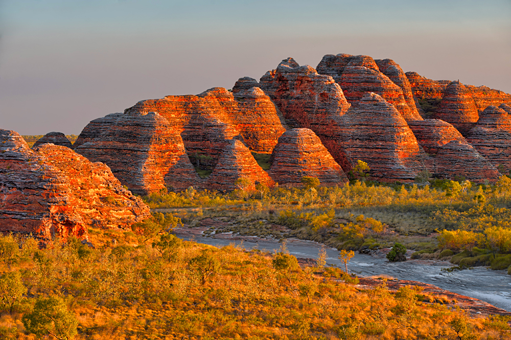 Beehives and Piccaninny Creek in warm evening light, Bungle Bungles National Park, Western Australia, Australia