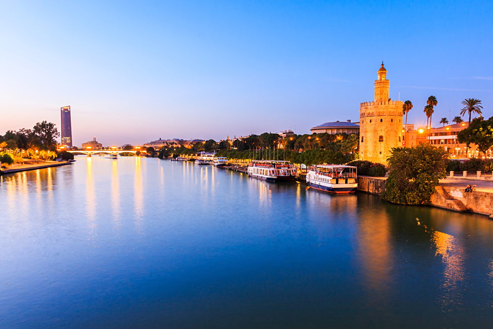 Guadalquivir River and Golden Tower (Torre del Oro), Seville, Andalusia, Spain