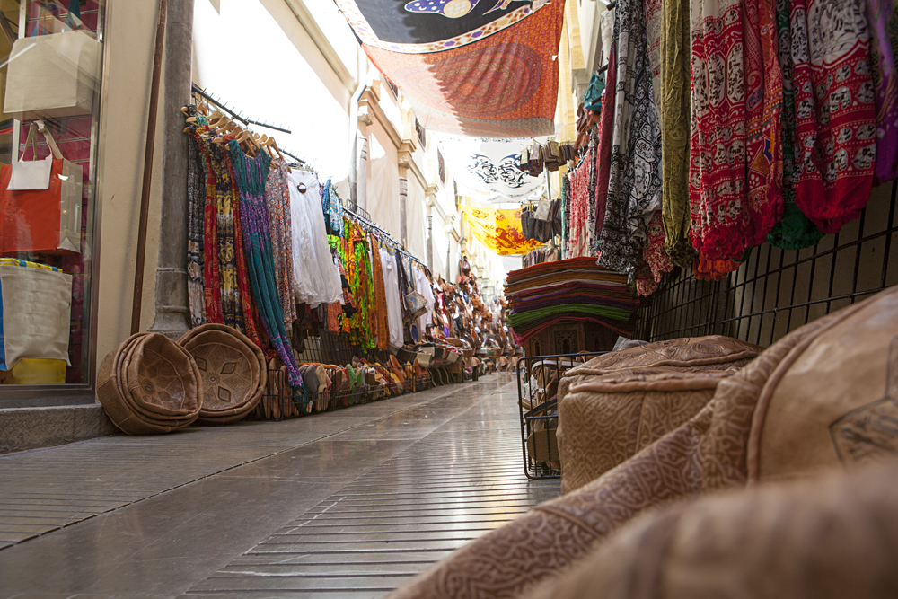 Narrow streets filled with shops in Alcaiceria District, originally home to a Moorish silk market, Granada, Andalusia, Spain