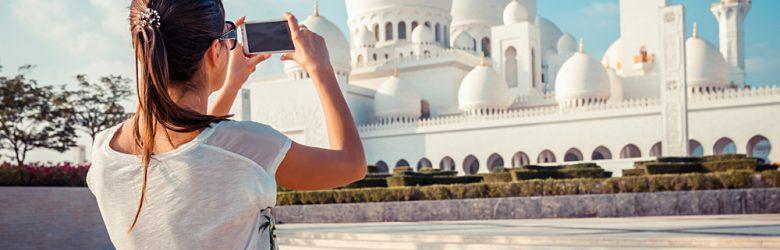 Woman Photographing Sheikh Zayed Grand Mosque, Abu Dhabi, United Arab Emirates (UAE)