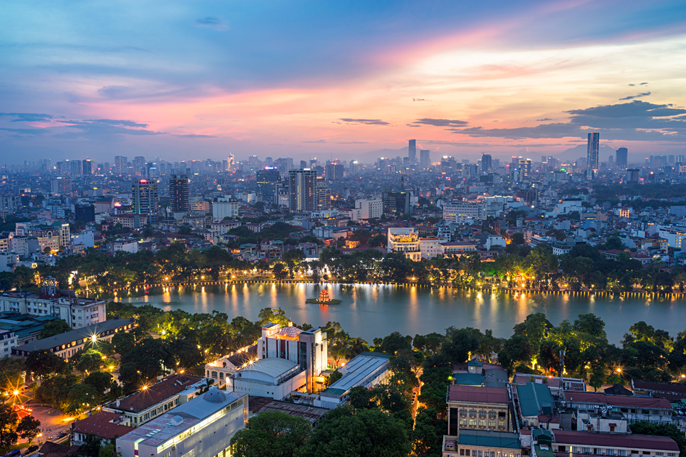 Aerial skyline view of Hoan Kiem and Ho Guom (Sword lake) area at twilight, Hanoi, Vietnam