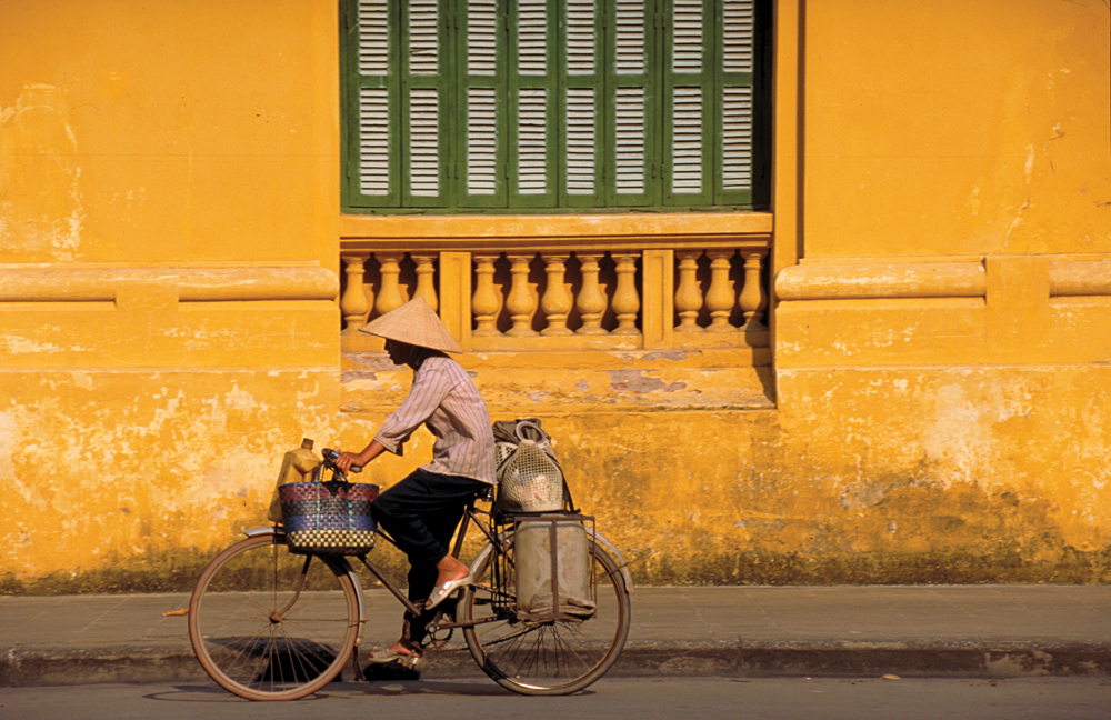 Cycling Along a Street in Hanoi, Vietnam