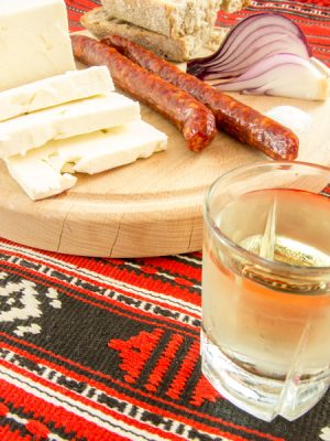 Traditional Romanian Snack of Cheese, Onion, Sausage, Bread and Plum Brandy (Tuica), Romania