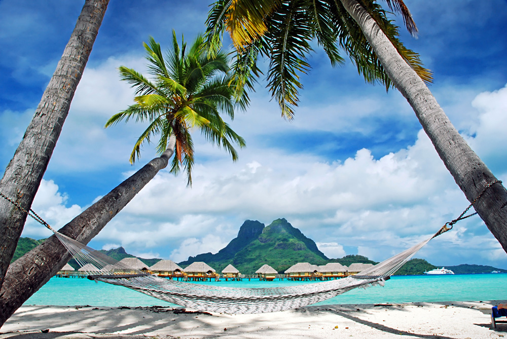 View of the Otemanu Mountain, Palm Trees and Empty Hammock, Bora Bora, Tahiti (French Polynesia)